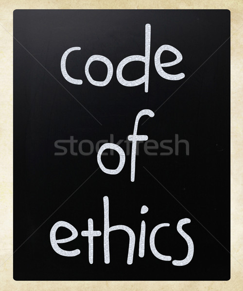 'Code of ethics' handwritten with white chalk on a blackboard Stock photo © nenovbrothers