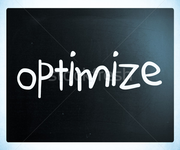'Optimize' handwritten with white chalk on a blackboard Stock photo © nenovbrothers