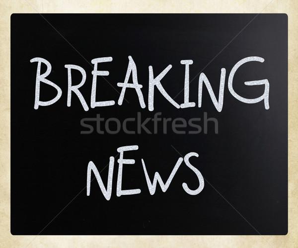 'Breaking news' handwritten with white chalk on a blackboard Stock photo © nenovbrothers
