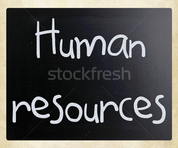 Stock photo: The word 'Human resources' handwritten with white chalk on a bla