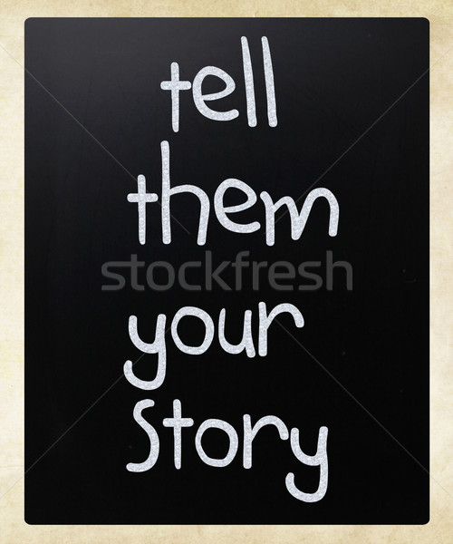'Tell them your story' handwritten with white chalk on a blackbo Stock photo © nenovbrothers