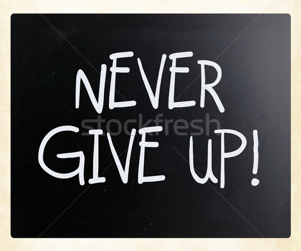 'Never give up' handwritten with white chalk on a blackboard Stock photo © nenovbrothers