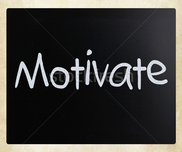 'Motivate' handwritten with white chalk on a blackboard Stock photo © nenovbrothers