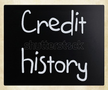 'Credit history' handwritten with white chalk on a blackboard Stock photo © nenovbrothers