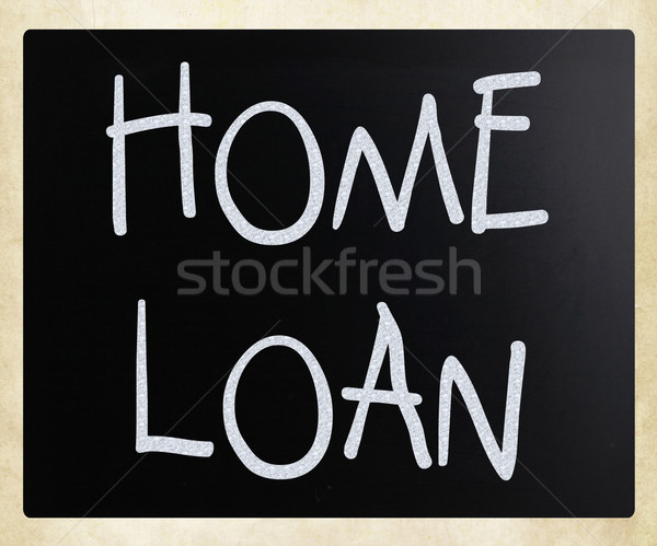 'Home loan' handwritten with white chalk on a blackboard Stock photo © nenovbrothers