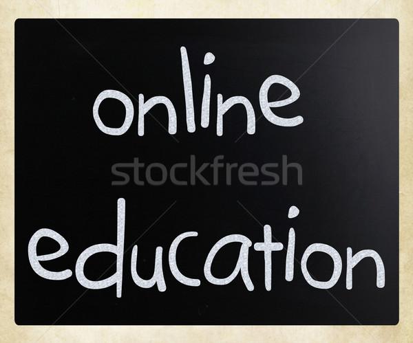 'Online education' handwritten with white chalk on a blackboard Stock photo © nenovbrothers