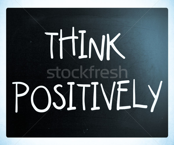 'Think Positively' handwritten with white chalk on a blackboard Stock photo © nenovbrothers