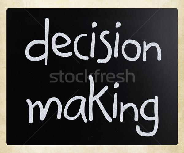 'Decision making' handwritten with white chalk on a blackboard Stock photo © nenovbrothers