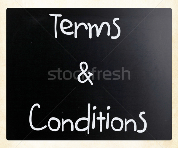 'Terms & Conditions' handwritten with white chalk on a blackboar Stock photo © nenovbrothers