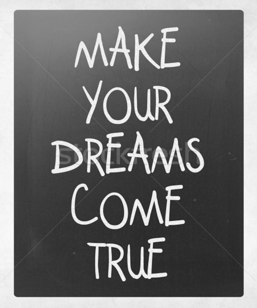 'Make your dreams come true' handwritten with white chalk on a b Stock photo © nenovbrothers