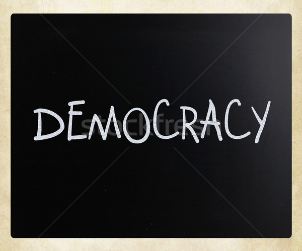 The word 'Democracy' handwritten with white chalk on a blackboar Stock photo © nenovbrothers