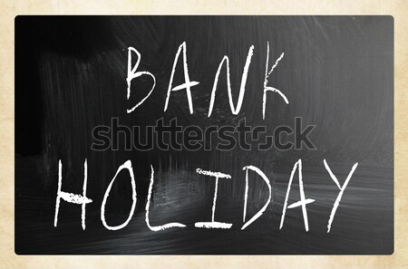 'Bank holiday' handwritten with white chalk on a blackboard Stock photo © nenovbrothers
