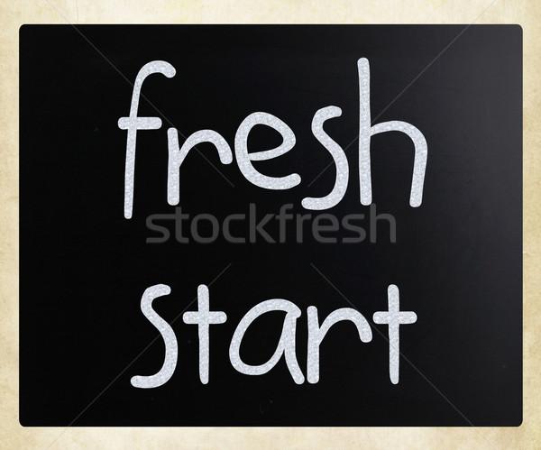 'fresh start' handwritten with white chalk on a blackboard Stock photo © nenovbrothers