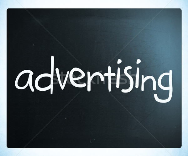 The word 'advertising' handwritten with white chalk on a blackbo Stock photo © nenovbrothers