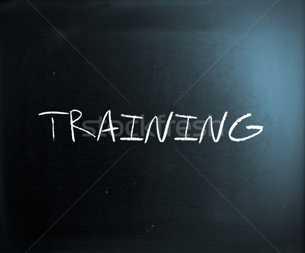 'Training' handwritten with white chalk on a blackboard Stock photo © nenovbrothers