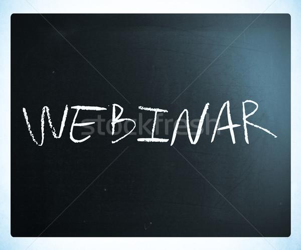The word 'Webinar' handwritten with white chalk on a blackboard Stock photo © nenovbrothers