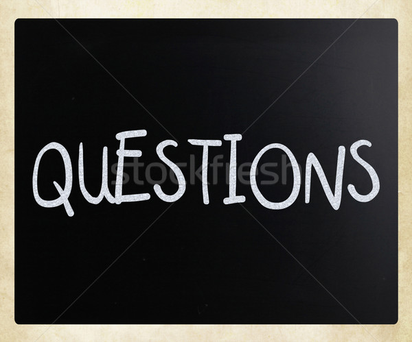 The word 'Questions' handwritten with white chalk on a blackboar Stock photo © nenovbrothers