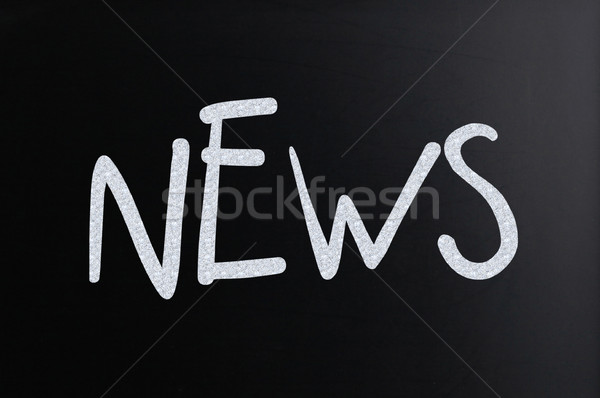 The word 'News' handwritten with white chalk on a blackboard Stock photo © nenovbrothers
