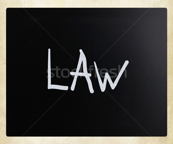 The word 'Law' handwritten with white chalk on a blackboard Stock photo © nenovbrothers