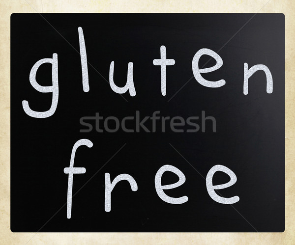 Gluten free diet concept - handwritten with white chalk on a bla Stock photo © nenovbrothers
