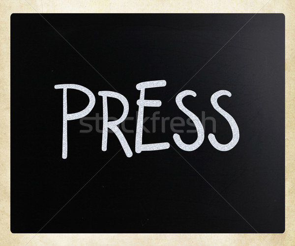 'PRESS' handwritten with white chalk on a blackboard Stock photo © nenovbrothers