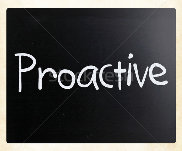 Stock photo: The word 'Proactive' handwritten with white chalk on a blackboar
