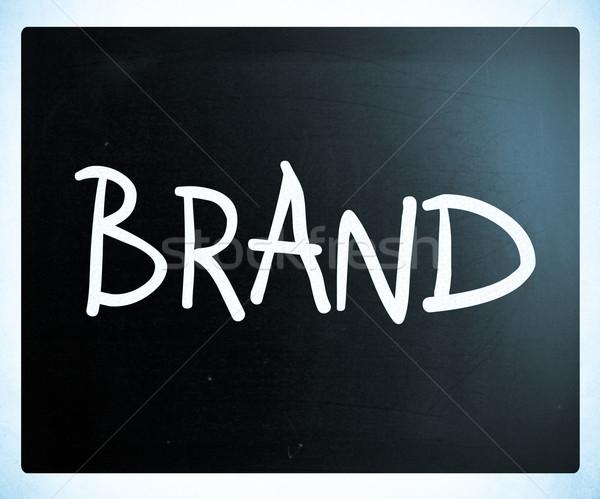 'BRAND' handwritten with white chalk on a blackboard Stock photo © nenovbrothers