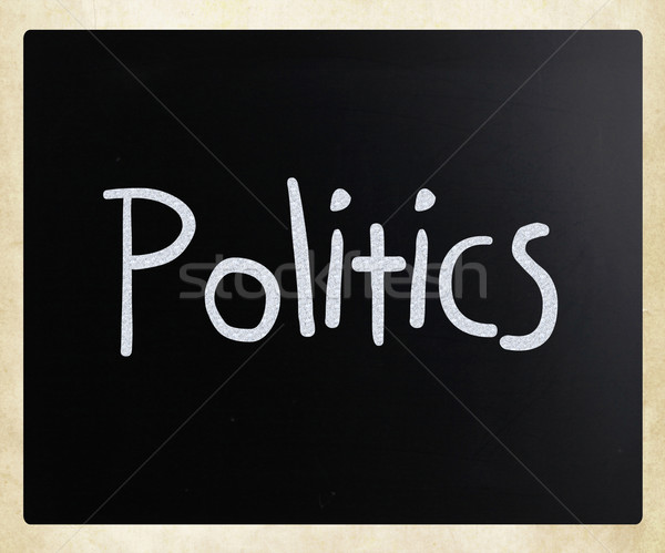 The word 'Politics' handwritten with white chalk on a blackboard Stock photo © nenovbrothers