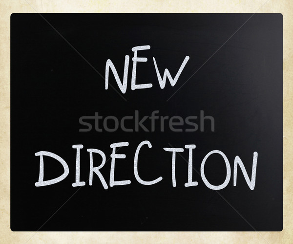 'New direction' handwritten with white chalk on a blackboard Stock photo © nenovbrothers