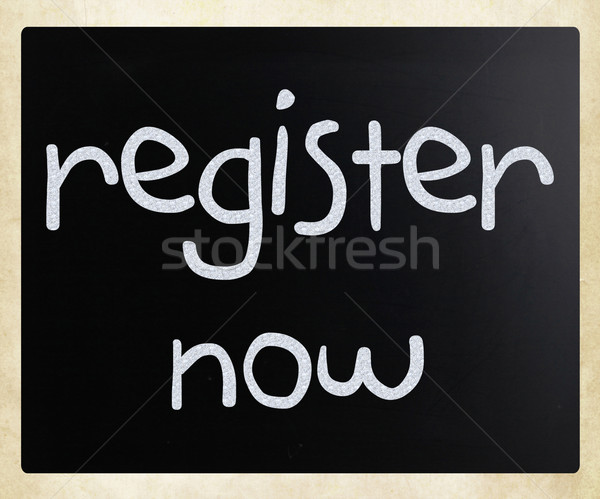 'Register now' handwritten with white chalk on a blackboard Stock photo © nenovbrothers