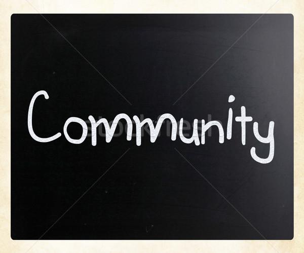 'Community' handwritten with white chalk on a blackboard Stock photo © nenovbrothers