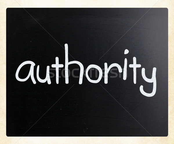'Authority' handwritten with white chalk on a blackboard Stock photo © nenovbrothers