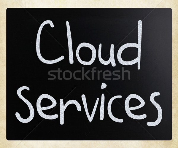 'Cloud services' handwritten with white chalk on a blackboard Stock photo © nenovbrothers