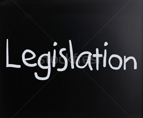 The word 'Legislation' handwritten with white chalk on a blackbo Stock photo © nenovbrothers