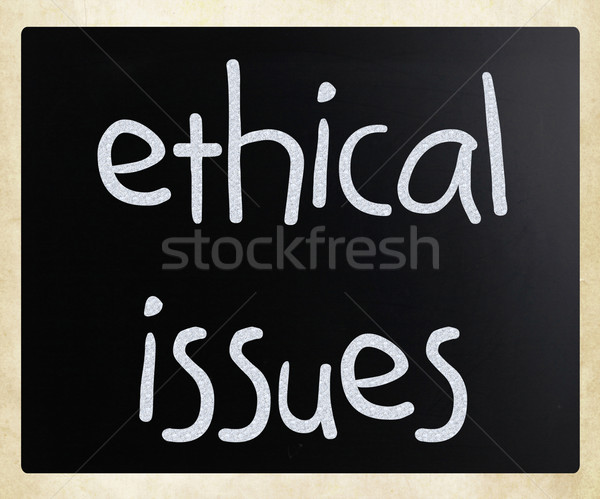 'Ethical issues' handwritten with white chalk on a blackboard Stock photo © nenovbrothers