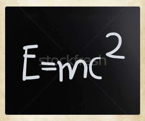 E=mc2 handwritten with white chalk on a blackboard Stock photo © nenovbrothers