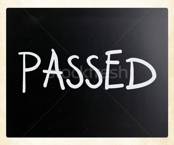 'Passed' handwritten with white chalk on a blackboard Stock photo © nenovbrothers