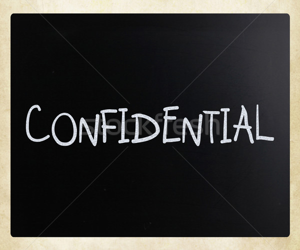 The word 'Confidential' handwritten with white chalk on a blackb Stock photo © nenovbrothers