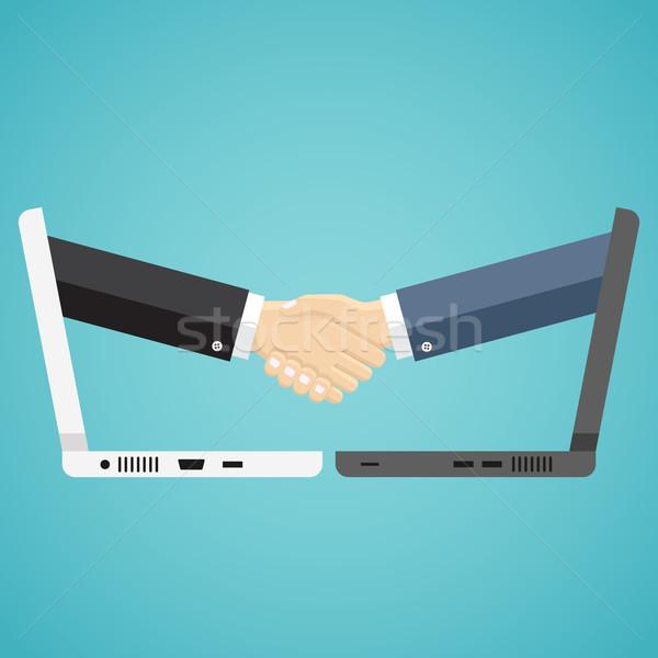 Biznesmenów Shake Hands dwa komputerów komputera Internetu Zdjęcia stock © Neokryuger