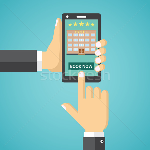 Booking a hotel room on a mobile device. Stock photo © Neokryuger
