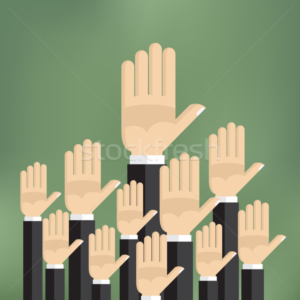 Raised hands on the green background. Stock photo © Neokryuger