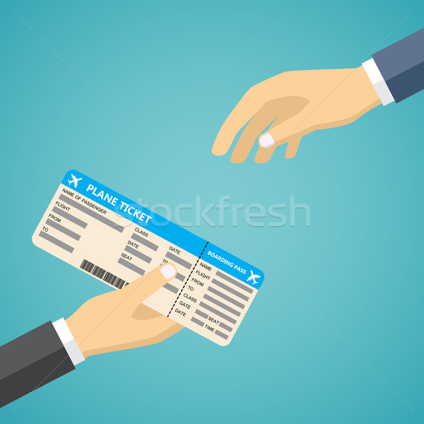 Businessman Receiving Boarding Pass at Airport. Stock photo © Neokryuger