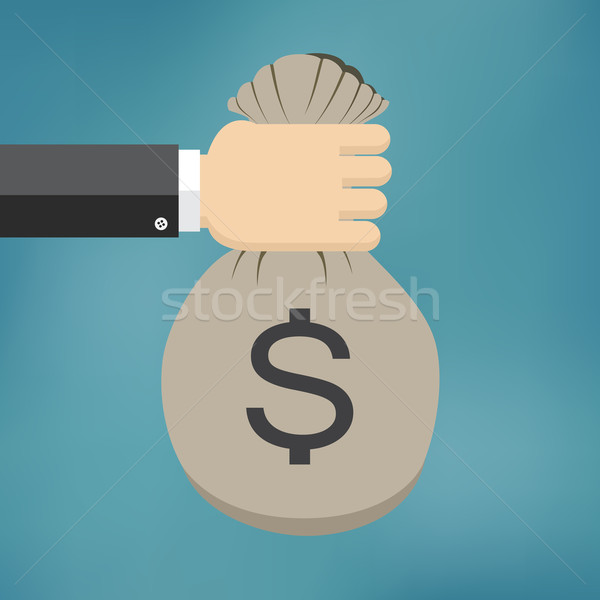 Hand with money bag. Stock photo © Neokryuger