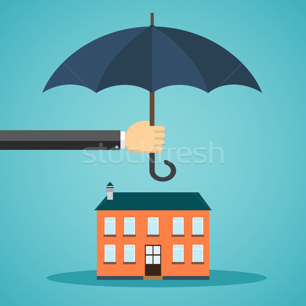 Hand holding umbrella over a house Stock photo © Neokryuger