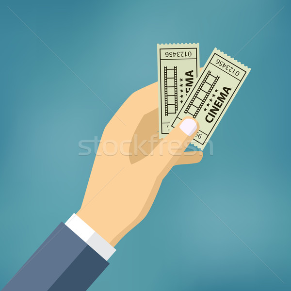 Hand with two cinema tickets. Stock photo © Neokryuger