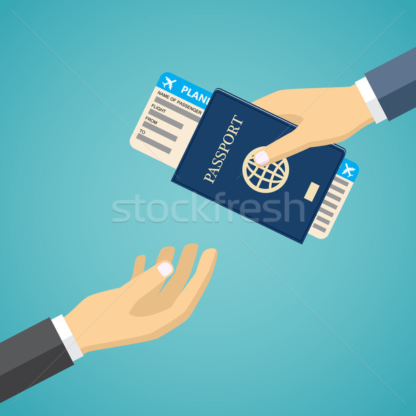 Businessman Receiving Boarding Pass and Passport. Stock photo © Neokryuger
