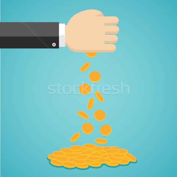 Queda moedas de ouro mão empresário dinheiro ouro Foto stock © Neokryuger