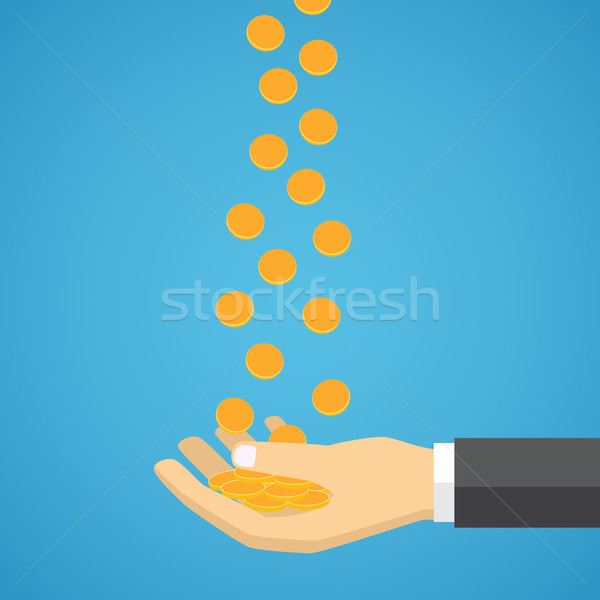 Gold coins fall into the hand. Stock photo © Neokryuger