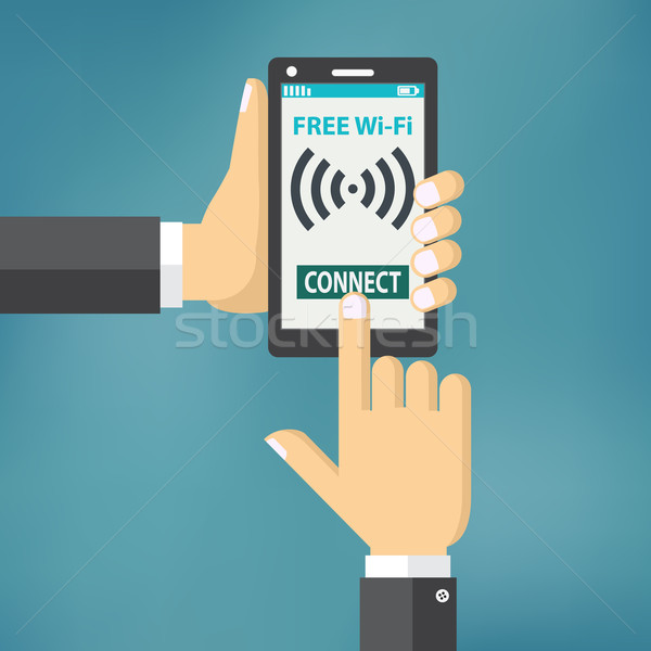 Hand holding smartphone with wifi. Stock photo © Neokryuger