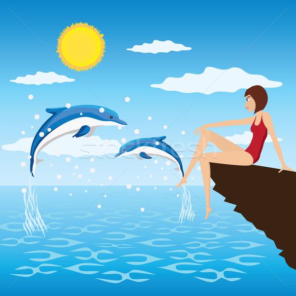 Kız yunuslar genç kadın oturmak deniz bakmak Stok fotoğraf © Neokryuger